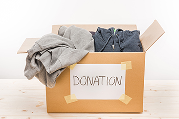 Box of Donated Clothing Items