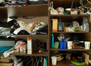 Messy cluttered shelves in a room